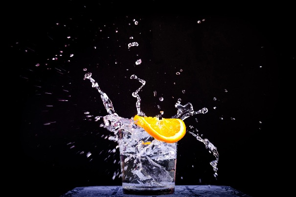 A glass of sparkling water and a slice of lemon