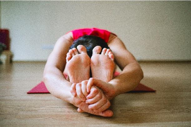 Bent forward yoga pose