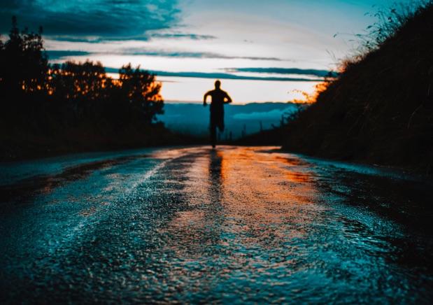Man running in the sunset